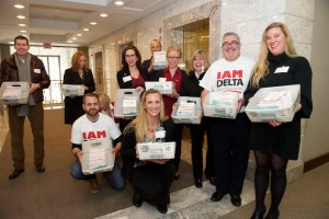 Delta Flight Attendants deliver more than 12,000 election request cards to the NMB in Washington DC.