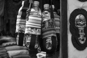 Peruvian holding bottles