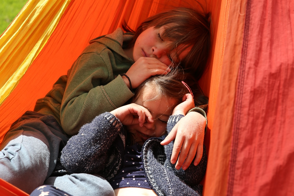 two kids in a hammock
