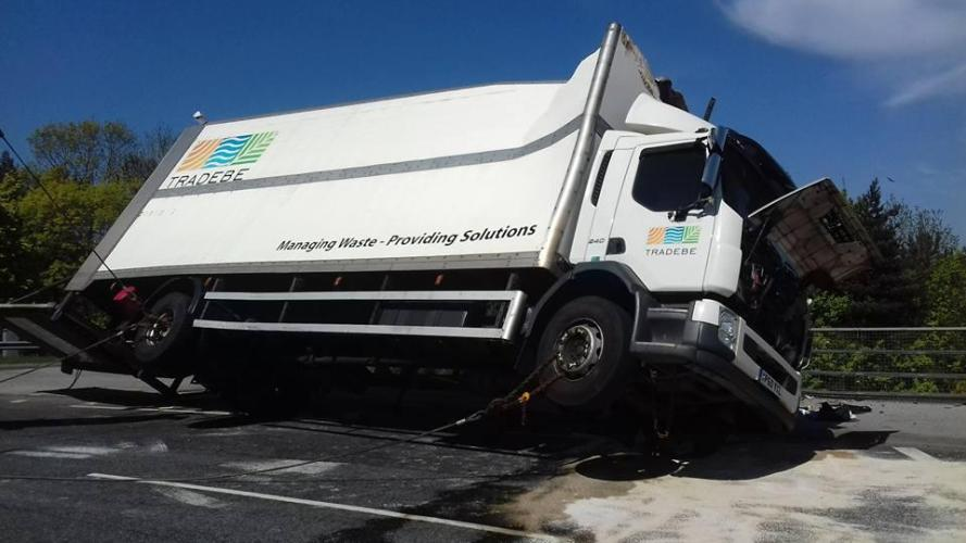 Lorry carrying clinical waste overturns on motorway bridge