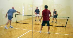 Pickleball is miniature tennis, but with more net play (click on image to enlarge or to source).
