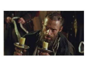 Jean Valjean and the silver candlesticks (click to enlarge or to source).
