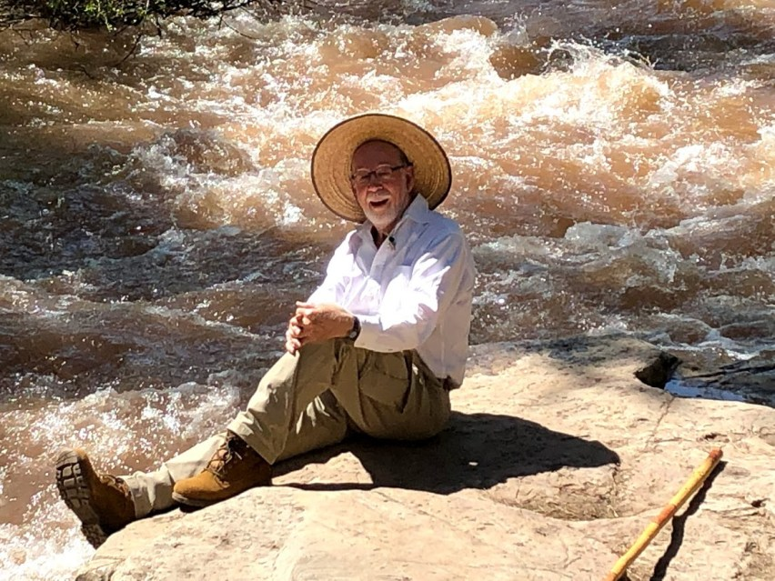 This image has an empty alt attribute; its file name is Ian-on-rock-in-river.jpg