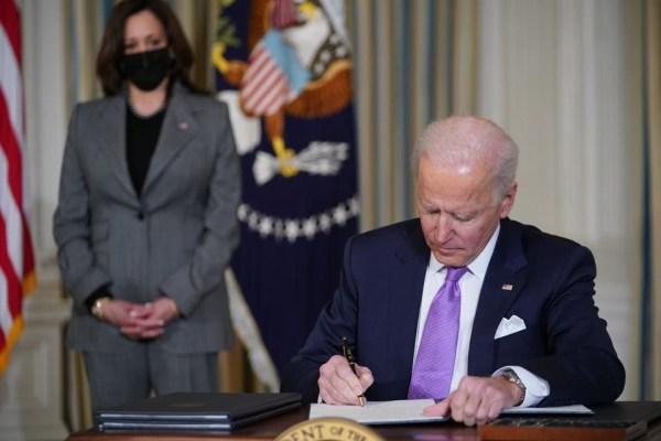 Photo President Biden signing executive orders