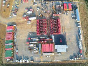 Massive frac-pumping equipment in center of photo