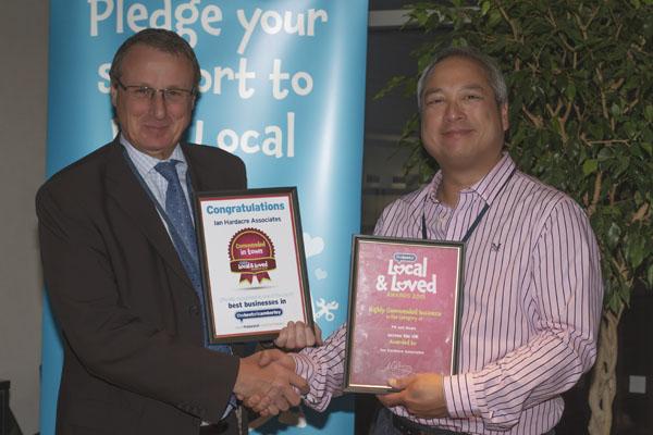 Ian Hardacre receiving his awards from David Yu, The Bestof Camberley