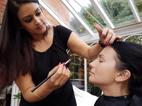 MUA Sonya Kaur getting Ana Maria's makeup perfect.