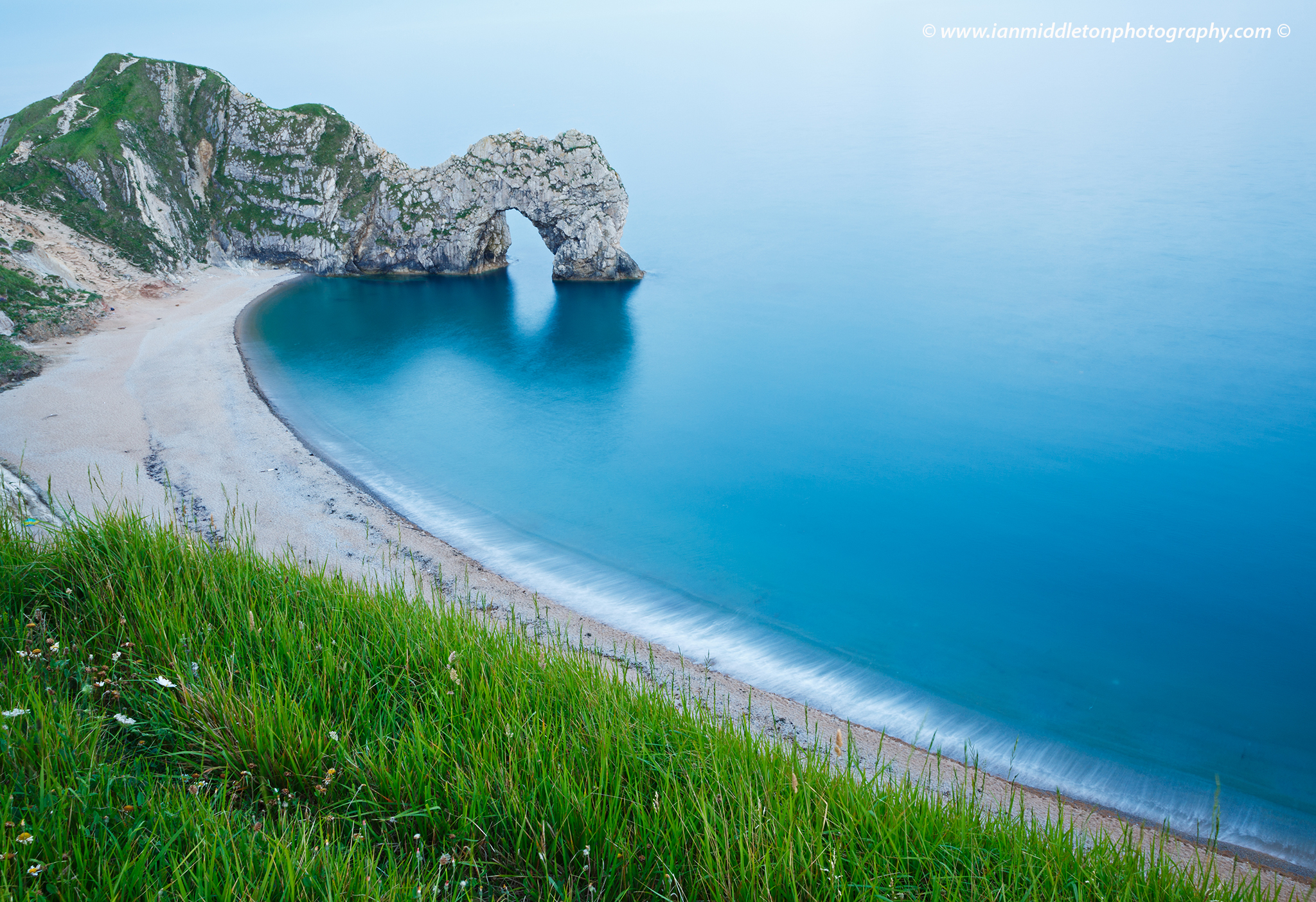 Evening view of Durdle Door beach, Dorset, England. Durdle door is one of the many stunning locations to visit on the Jurassic coast in southern England.