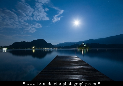 Supermoon visible over the beautiful island church of the assumption of Mary, Lake Bled, Slovenia. Taken on the evening of Sunday June 23rd 2013 when the moon was full.