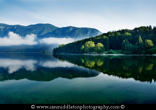 Morning mist and cloud over Lake Bohinj, Triglav National Park, Slovenia
