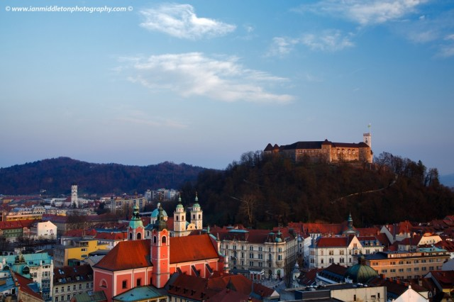 View across the centre of Ljubljana and the Franciscan Church and hilltop castle, Slovenia. Seen from Neboticnik, the skyscraper.