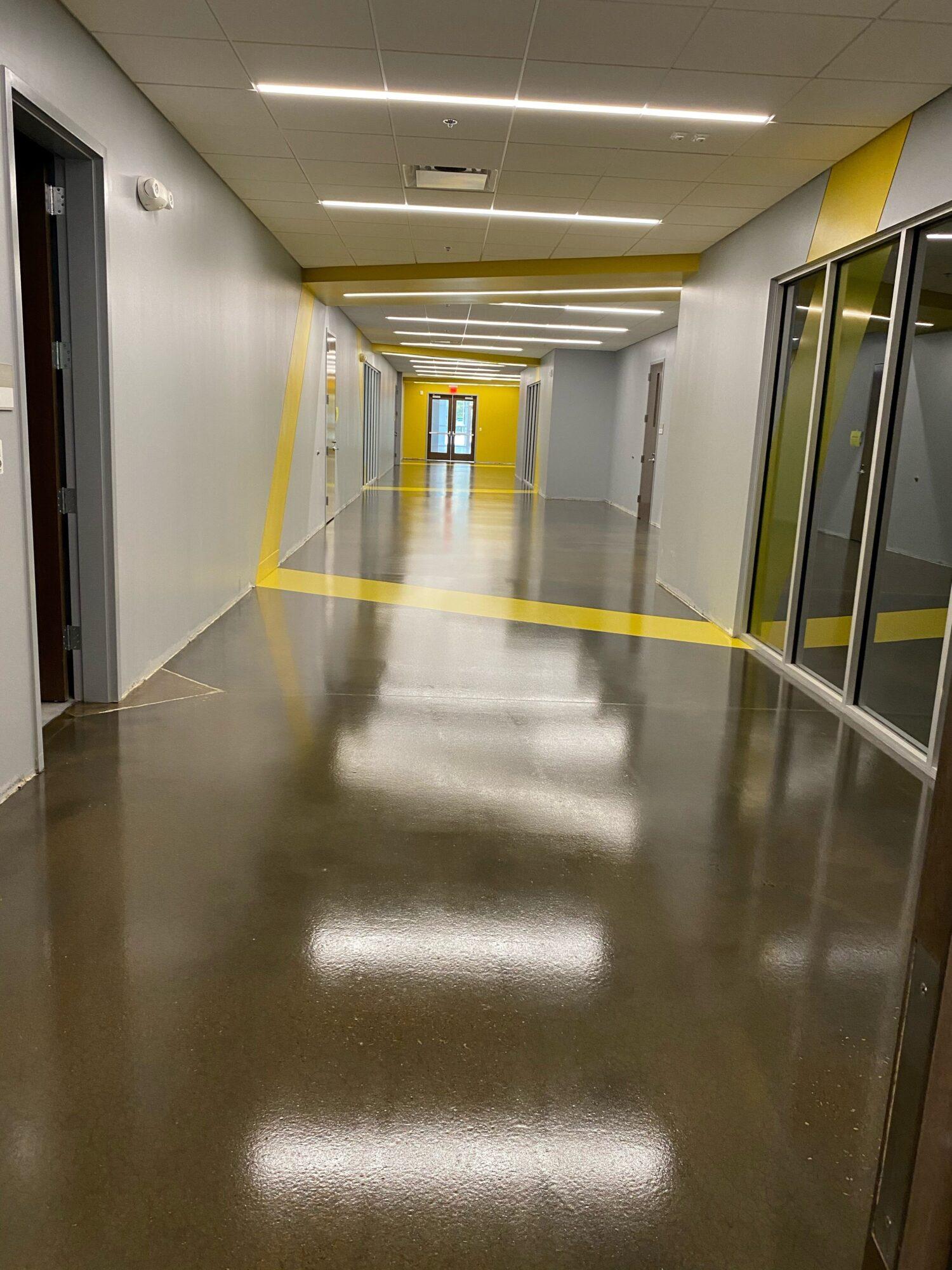 Concrete floor coatings, epoxy floor coatings, epoxy coatings, Industrial Applications Inc, TeamIA, epoxy floor coating, educational center flooring, educational epoxy flooring