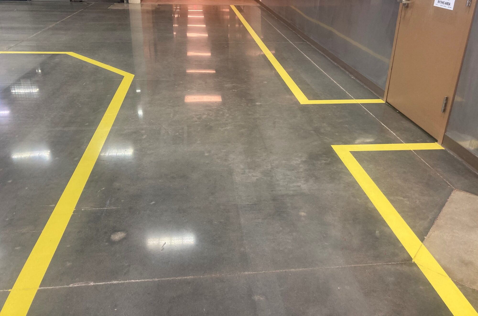 Safety striping, polished concrete, Polished concrete floors, industrial safety, pedestrian walkways in manufacturing, epoxy floor markings, 5S, TeamIA, Industrial Applications Inc, epoxy flooring solutions, flooring contractors Memphis TN, Memphis TN