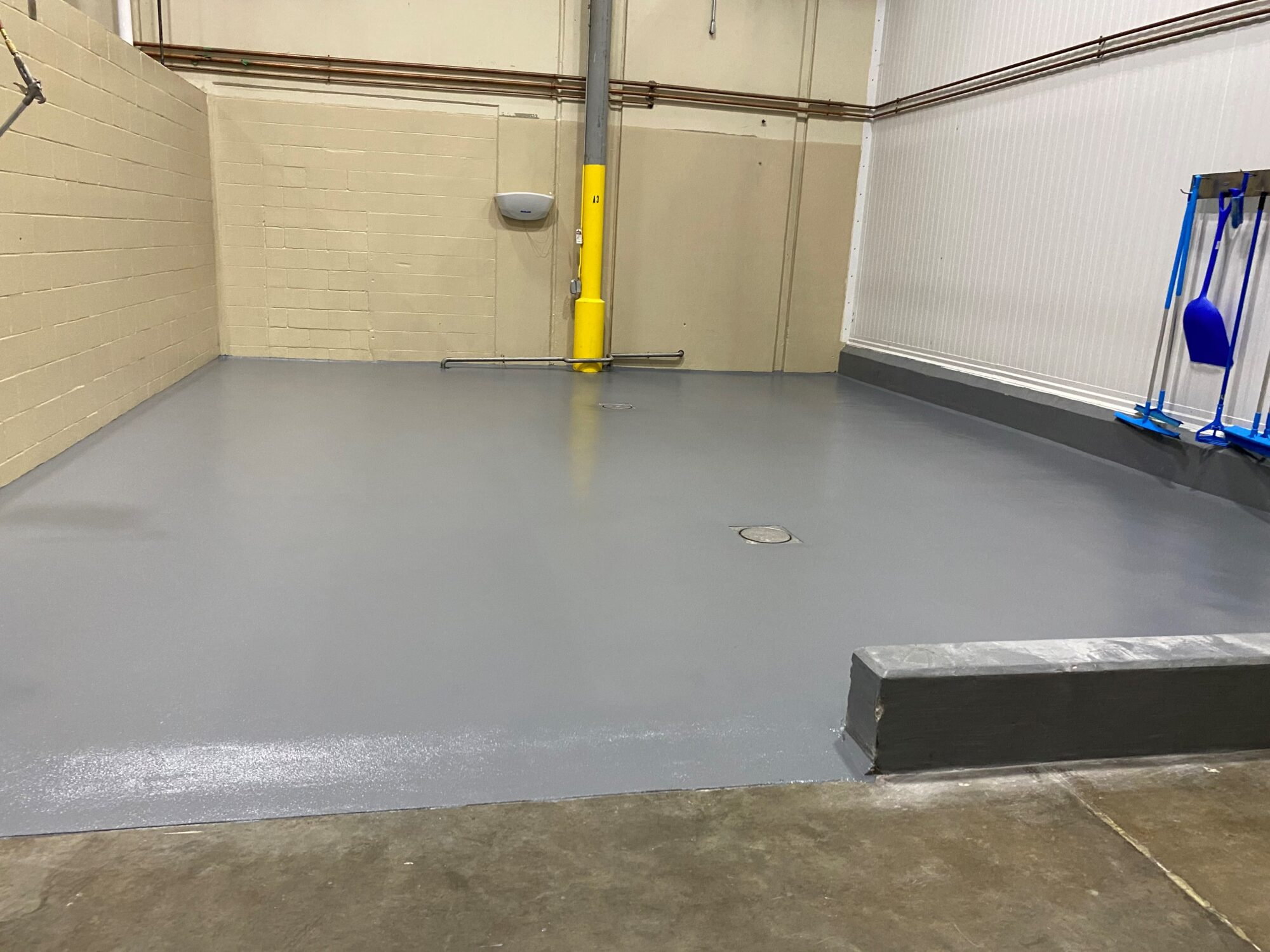 TeamIA, concrete floor resurfacing, industrial flooring, flooring contractors Jackson TN, urethane concrete, Industrial Applications Inc., Jackson TN