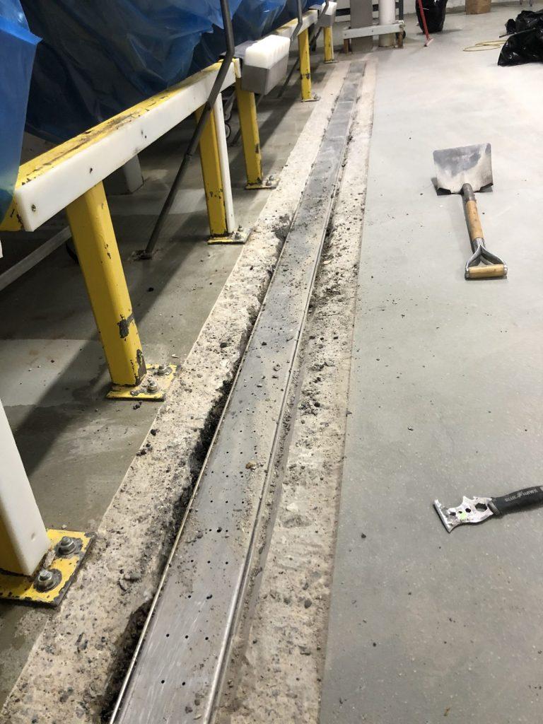 Hand trowel urethane cement, urethane concrete, rebuild concrete trench drain, Industrial Applications, Inc., IA30yrs, concrete floor coatings, resurfacing concrete floor