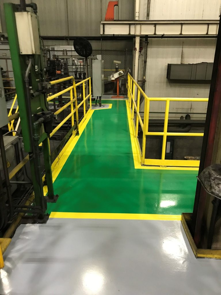 Epoxy floor coating, concrete floor coatings, epoxy coatings, epoxy floor coatings, epoxy coating, safety striping, manufacturing aisles, Industrial Applications, Inc, IA30yrs