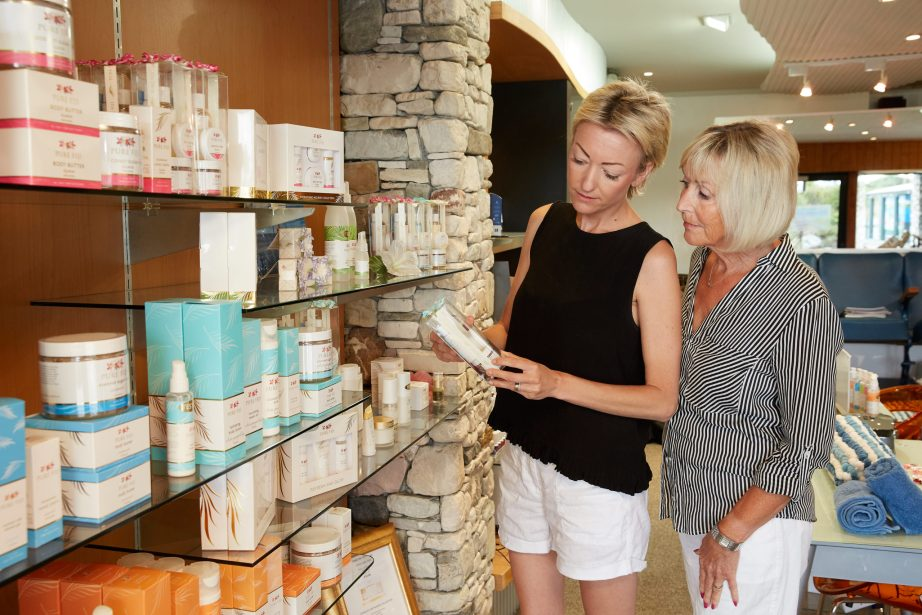 Mother & Daughter looking at product