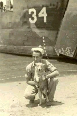 Ralph E. Robinson with Landing Ship Medium 34 and Gizmo somewhere in the Philippines, 1944 or 1945