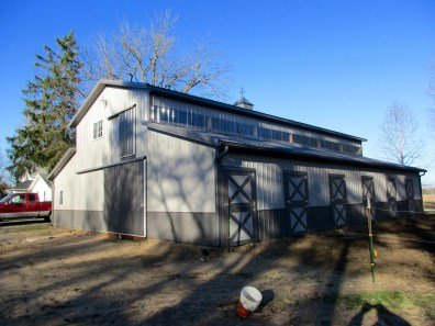 Kathy-Rolling Prairie, IN 24x60x17 with two 12x60x9 lean toos. Charcoal roof, and Grey sides.