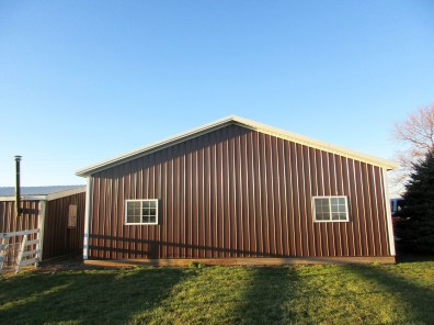 Larry-Wakarusa, IN 36x28x10 White roof & trim, and Brown sides.