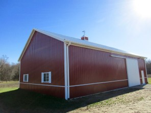 Terry-Three Oaks, MI 40x56x14 White Roof, and Rustic Red sides.