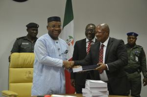 Presentation of report to Governor Udom Emmanuel by the Chairman of the Board of inquiry reviewing the Operations of Akwa Savings and Loans Limited from 2007 - 2016