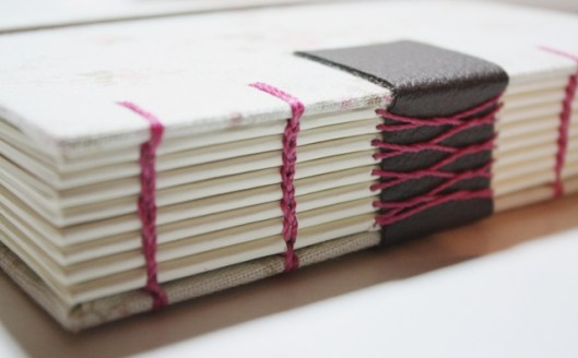 Coptic and French stitching on tapes by Magda Ribeiro