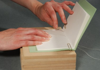Sewing-Signatures-into-Endsheets-during-Bookbinding-Process
