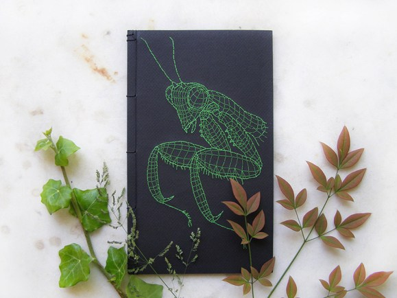 embroidered-praying-mantice-on-book-front-cover