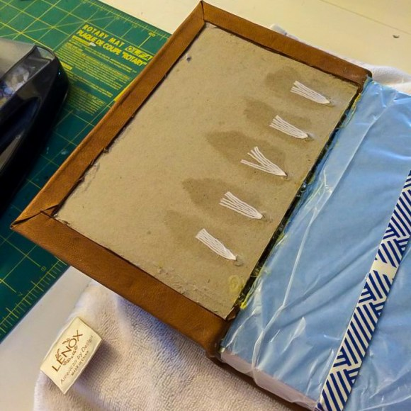 i Bookbinding - Prior to gluing down end papers