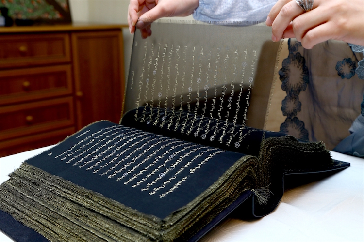 2016-12-02-quran-written-on-transparent-silk-pages-02