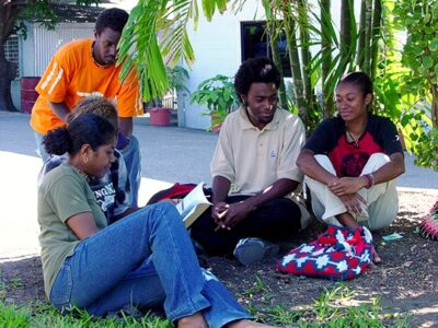 Students studying on the grounds of IBS College