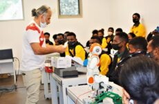 Mr. Shahram explaining the functions of robotics to Sogeri National High School students at the IBSUniversity