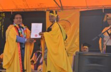 Minister for Higher Education, Research, Science and Technology, Hon. Wesley Raminai (right) presenting the degree certificate to a graduand during IBS
