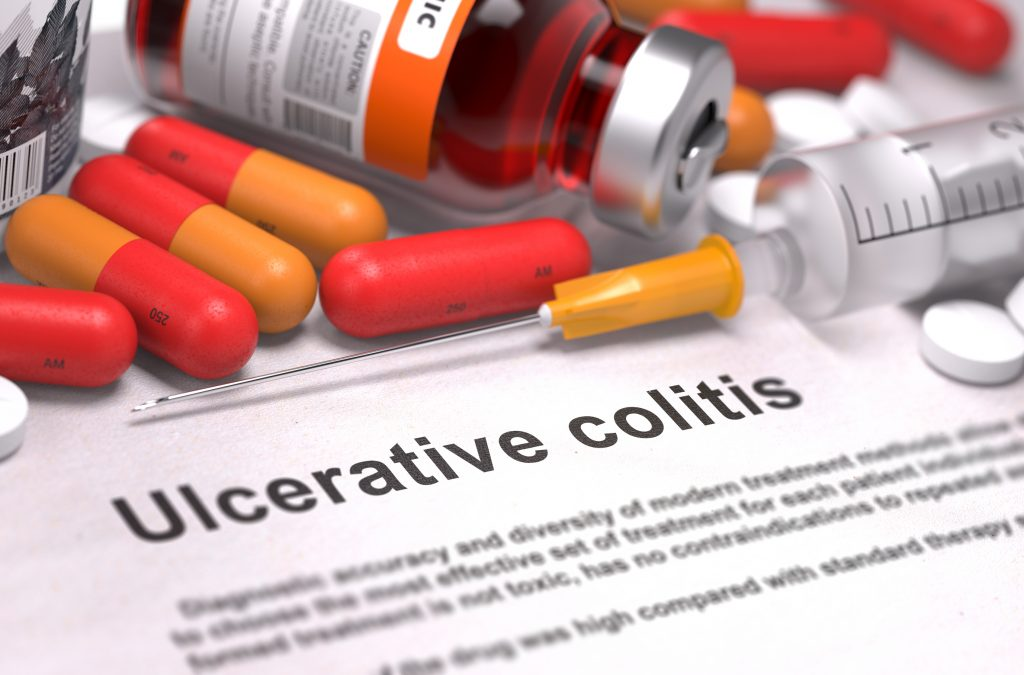 image of medicines and ulcerative colitis on paper