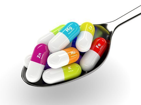 3d rendering of dietary supplements on spoon isolated over white.