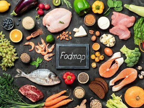 Fodmap on backboard surrounded by food