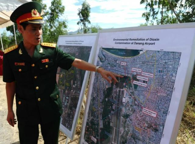 A Vietnamese army colonel pointing out dioxin-contaminated areas in 2012