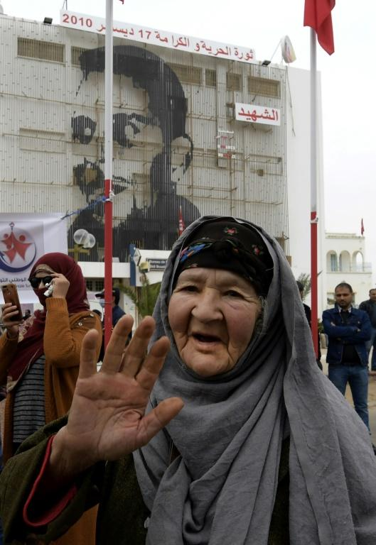 A December 17 picture shows commemorations 10 years after the self-immolation of Tunisian street vendor Mohamed Bouazizi at a square named in his honour in the central town of Sidi Bouzid