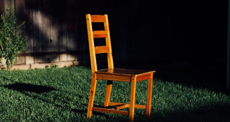 A Chair in a field at night