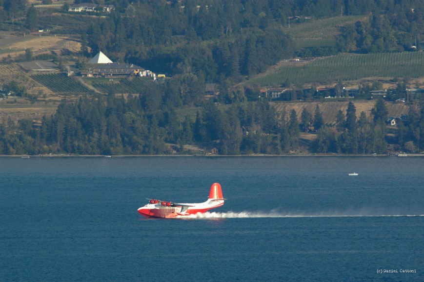 September 1st, 2003 - 17:58 PST The Martin Mars waterbomber was scooping in the middle of Okanagan Lake with the Summerhill Winery Pyramid in the background.