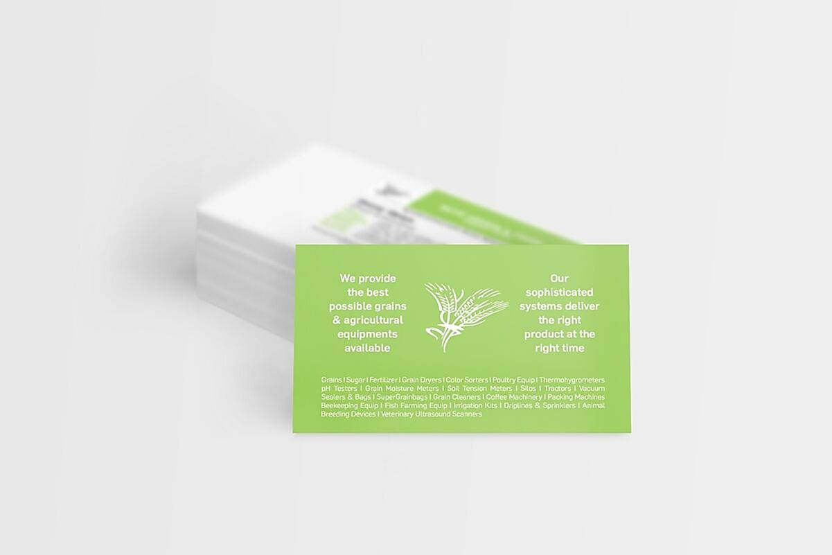 grenn business card leaning against stack