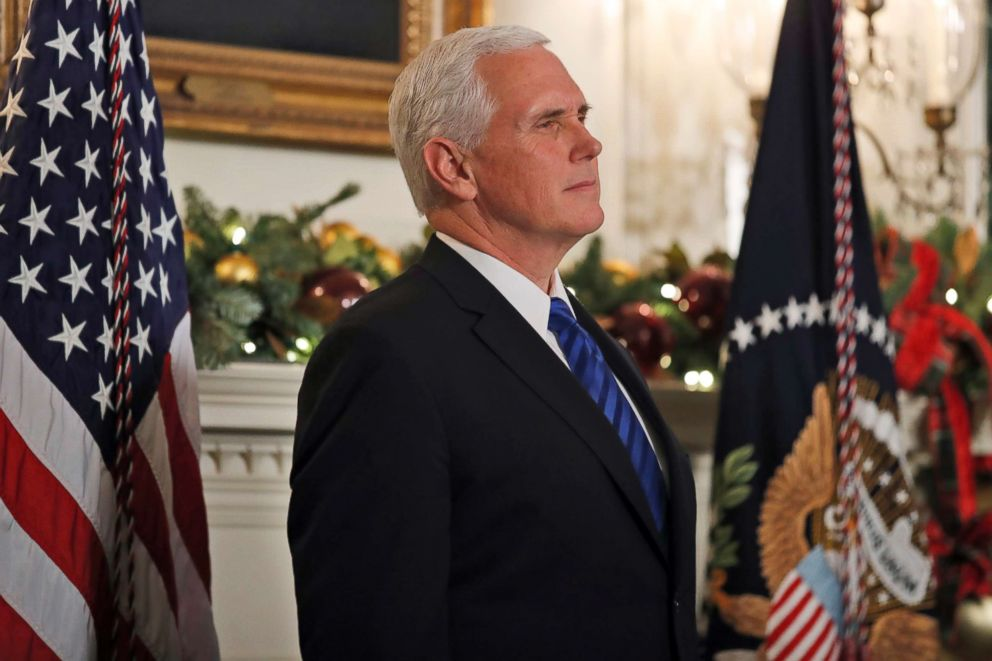 PHOTO: Vice President Mike Pence listens as President Donald Trump speaks in the Diplomatic Reception Room of the White House, Dec. 6, 2017, in Washington.