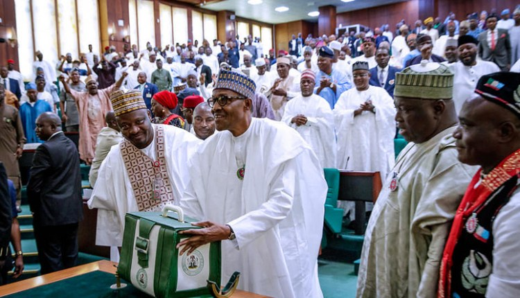 Image result for buhari signs 2019 budget