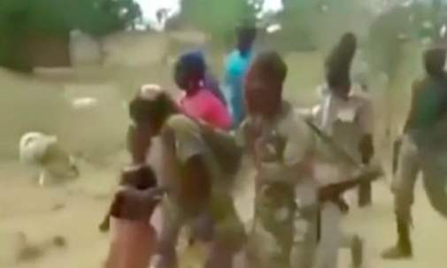 Cameroonian soldiers leading the two women and two children away to a remote place for murdering. Photo credit: Facebook.