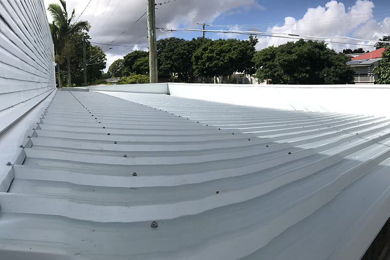 Photo of an asbestos roof replacement job