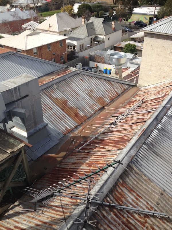 2 Auburn hotel commercial roofing before