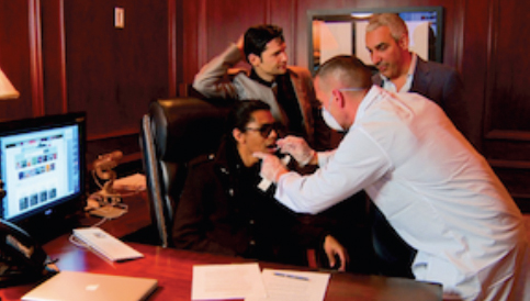 B Howard getting a swab for DNA testing as Corey Feldman and FilmOn CEO Alki David stand by.