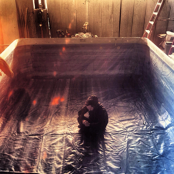 Steven C. Miller prays to the Water Gods on set.