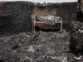 A piece of furniture sits inside a burned home in Leer, South Sudan on Saturday. /CC BY-NC-ND/ICRC/P. Krzysiek